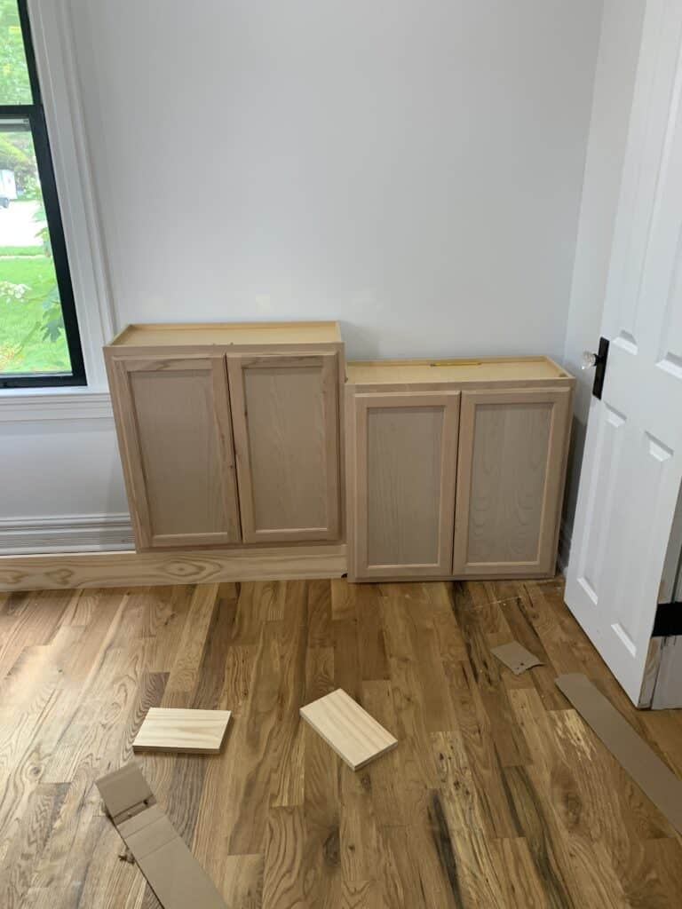 attaching stock cabinets to walls