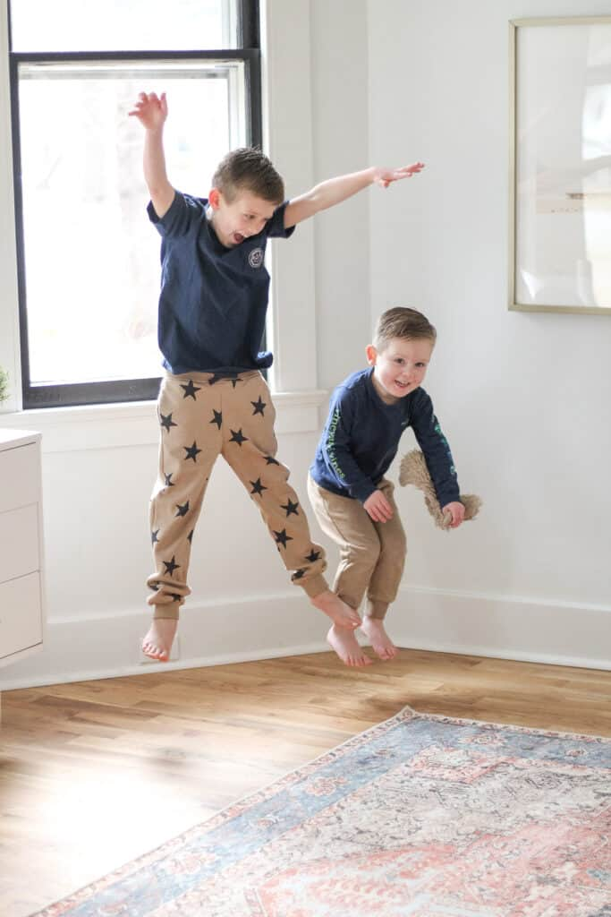two boys jumping