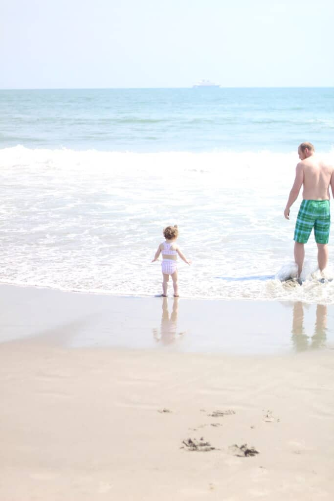 dad and baby girl at the beach