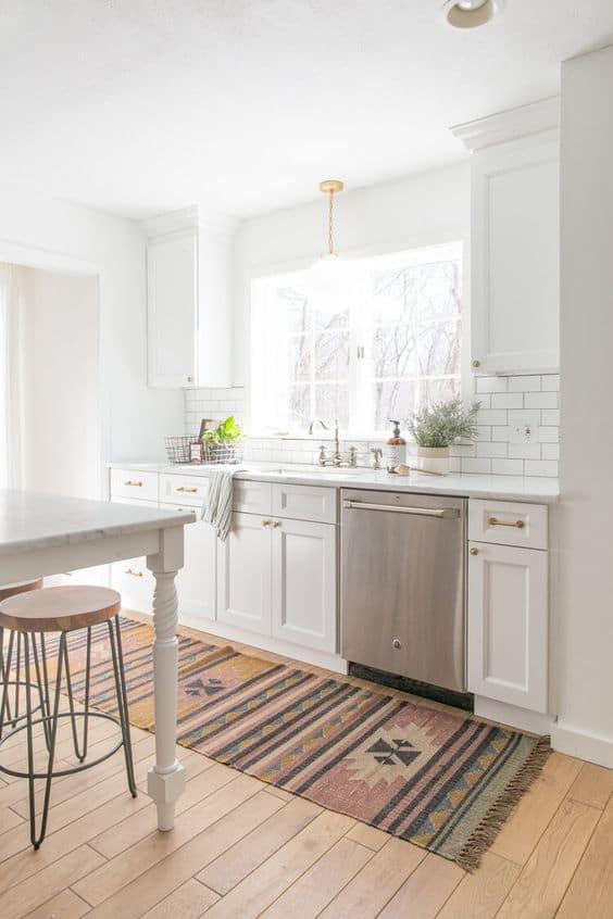 white kitchen with runner rug