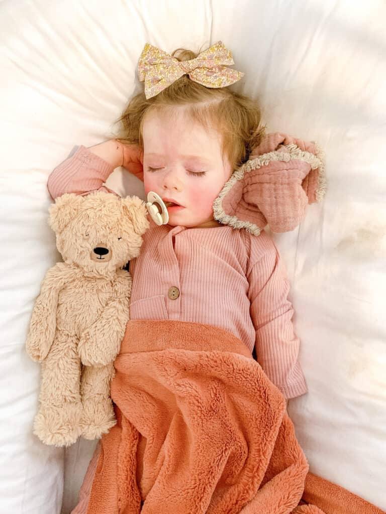 baby girl sleeping in Dock a Tot
