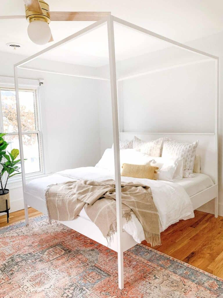 master bedroom with white canopy bed