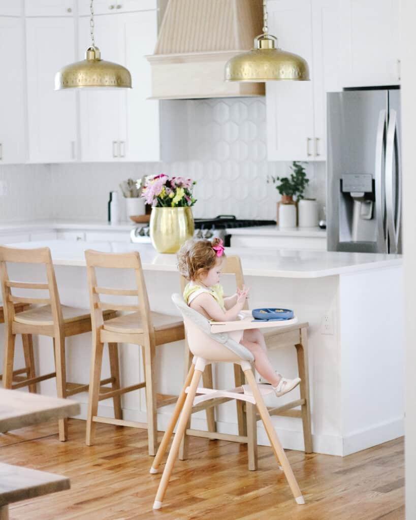 toddler girl in white kitchen