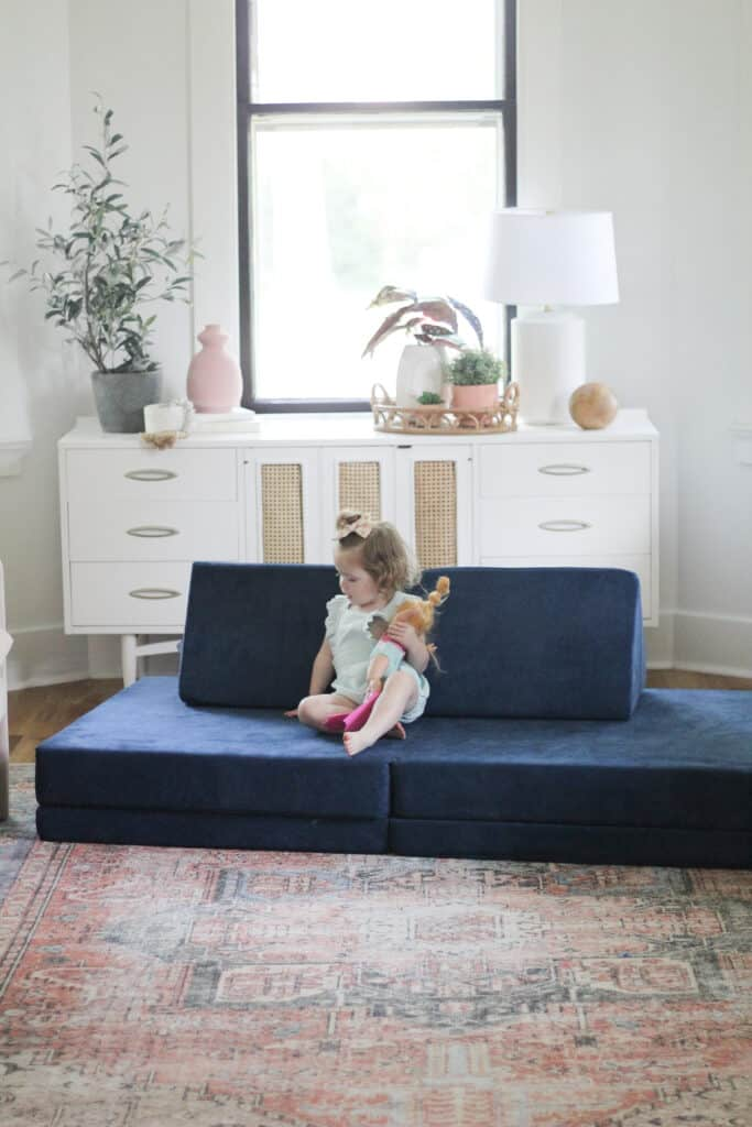 toddler girl on Nugget Couch