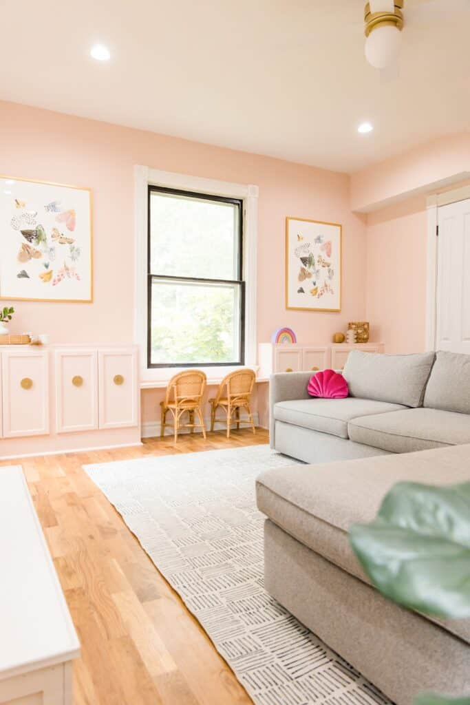 pink playroom with grey couches