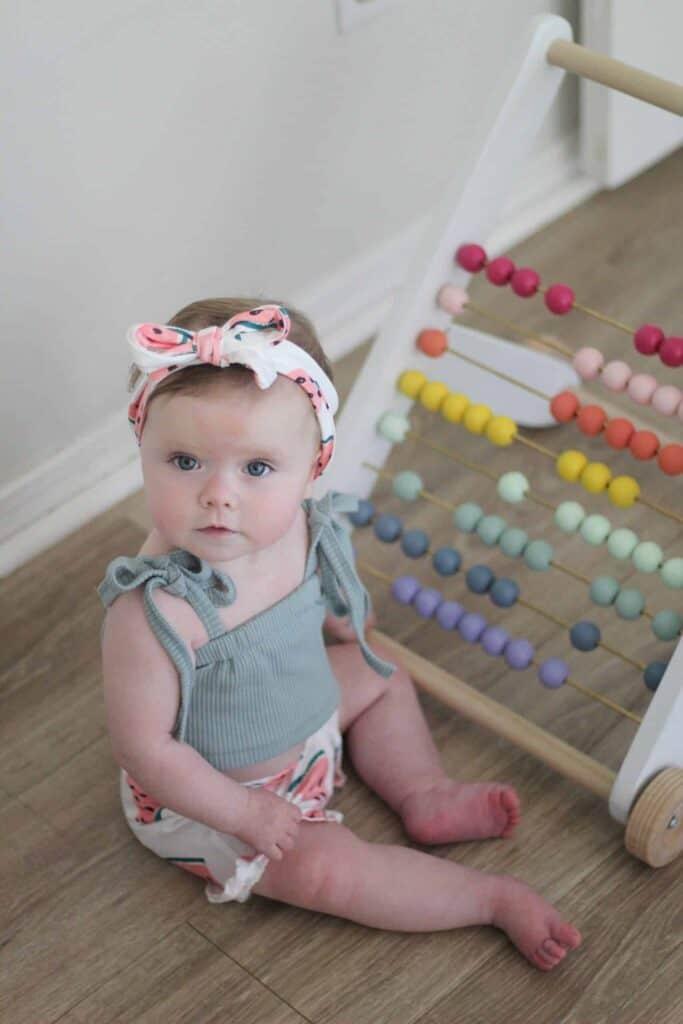 Toddler girl with DIY Push toy