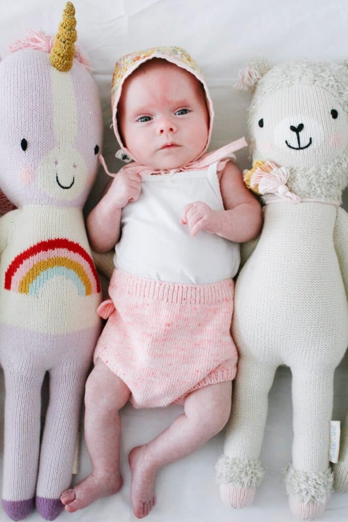 baby with cuddle and kind dolls