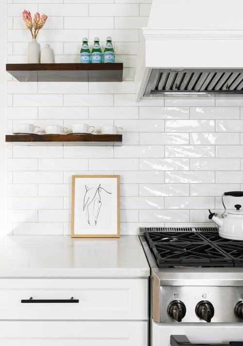 glossy white backsplash in white kitchen