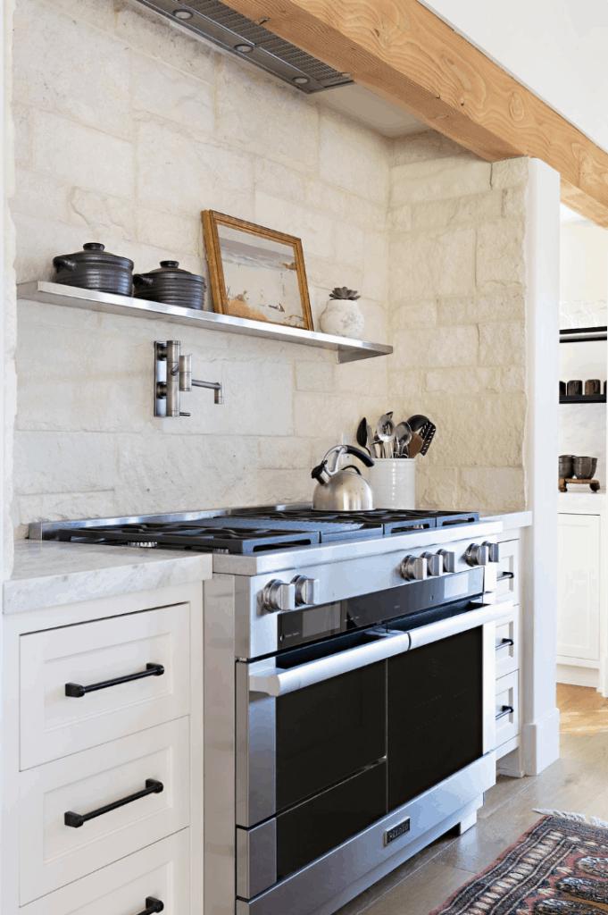 natural backsplash in white kitchen