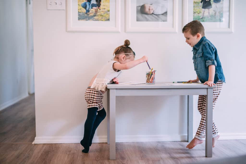 Toddlers coloring at small table