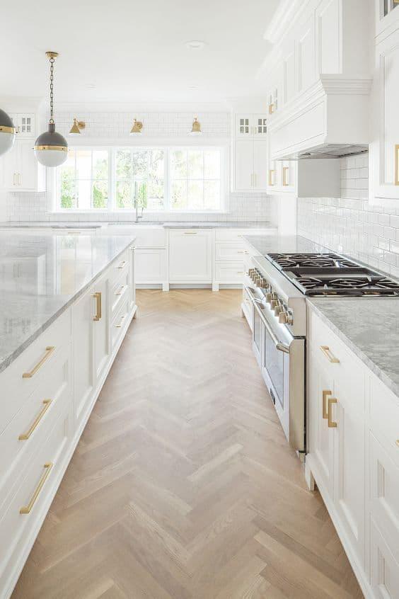 white kitchen with herringbone floors