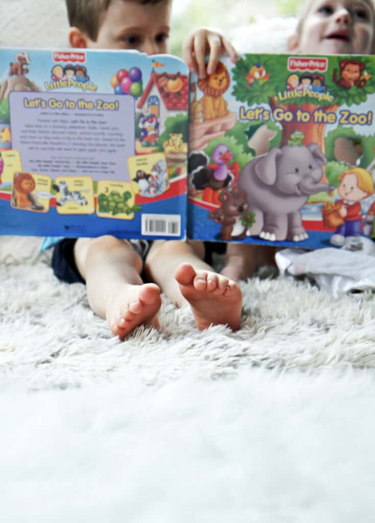 Toddlers reading a book