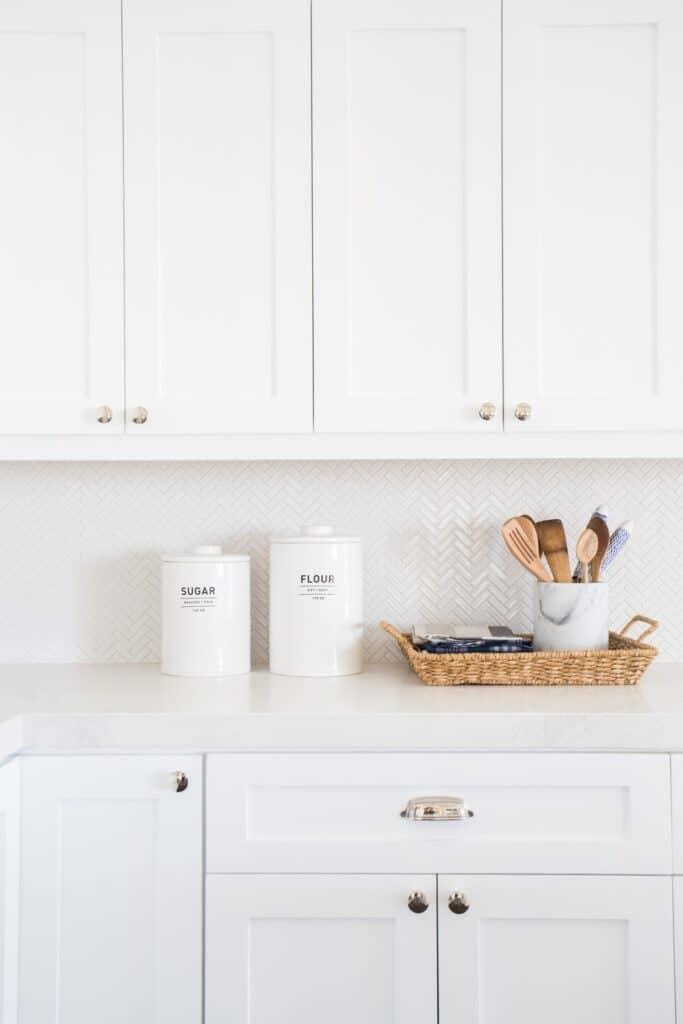 white kitchen cabinets with small white backsplash