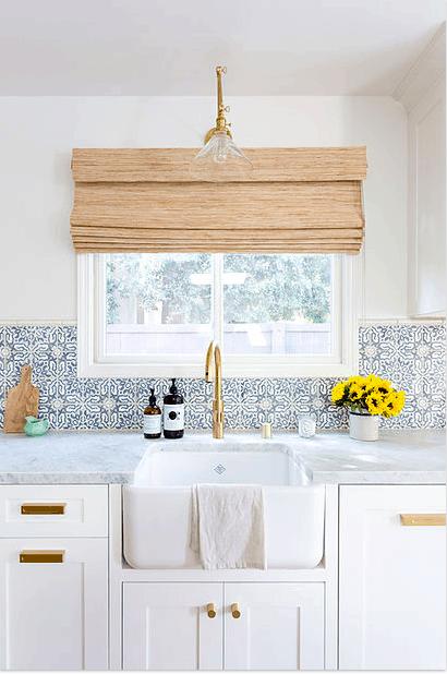 white kitchen with blue backsplash