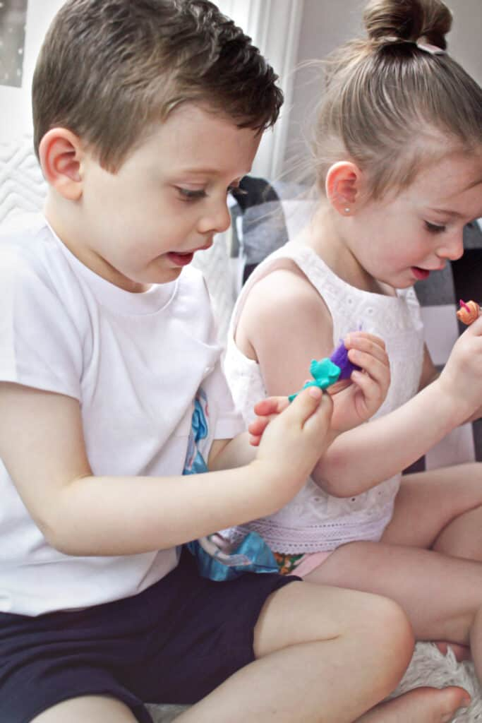 Toddlers playing with small toys