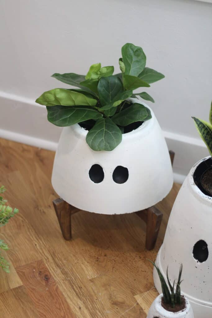 ghost planter on wood legs