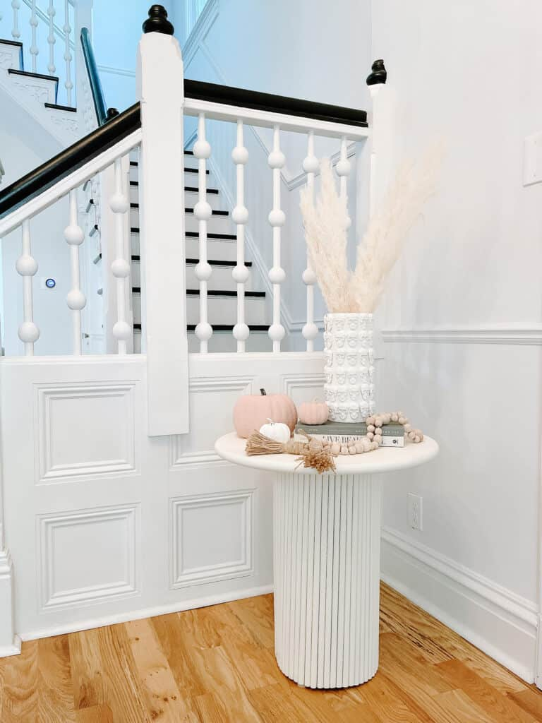 fluted end table and skull planter