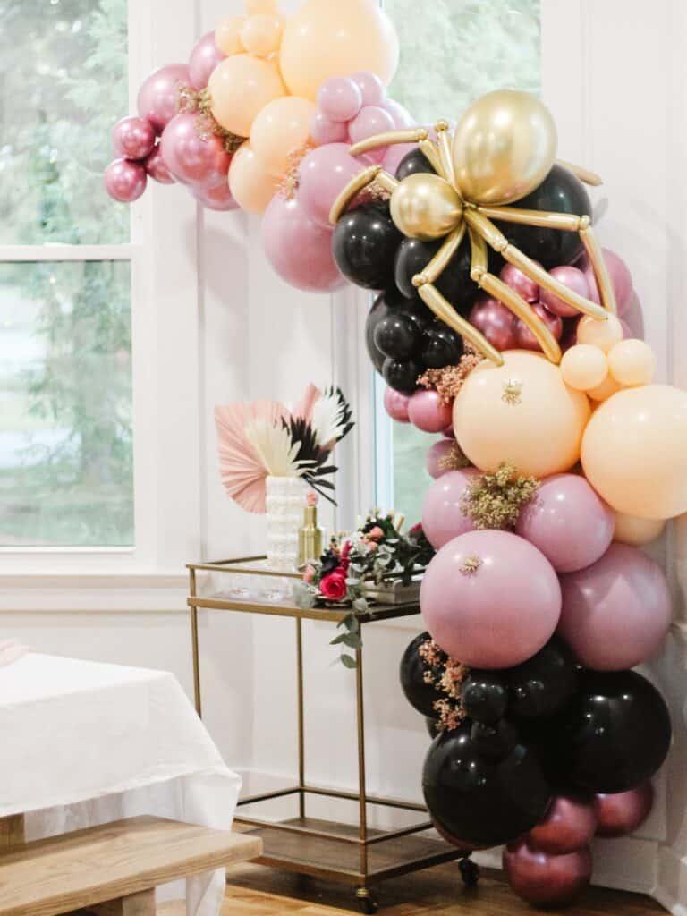 Balloon garland for Halloween over Bar Cart