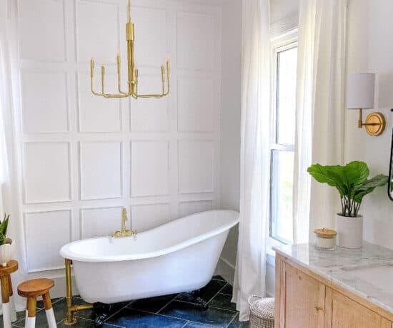 bathroom with claw foot tub and dark floors