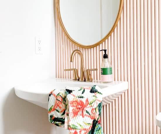 Pink bathroom with Pedestal Sink