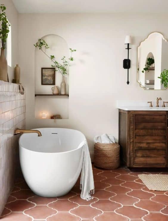 Modern fixtures meet Mediterranean design in primary bath