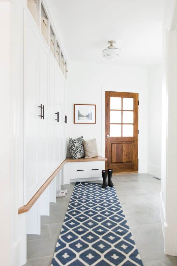 Neutral mudroom with wood tones